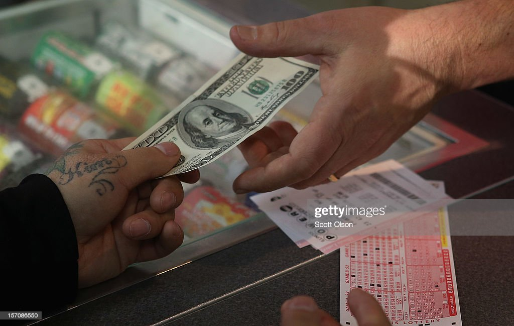 A customer purchases a Powerball lottery ticket at a 7-Eleven store on November 28, 2012 in Chicago, Illinois. Jim Bayci, who owns the store, estimates more than half of his customers included at least one Powerball ticket with their purchase today. The jackpot for Wednesday's Powerball drawing is currently at $550 million which is the richest Powerball pot ever. It is likely to rise even more as people continue to buy before tonights drawing.
