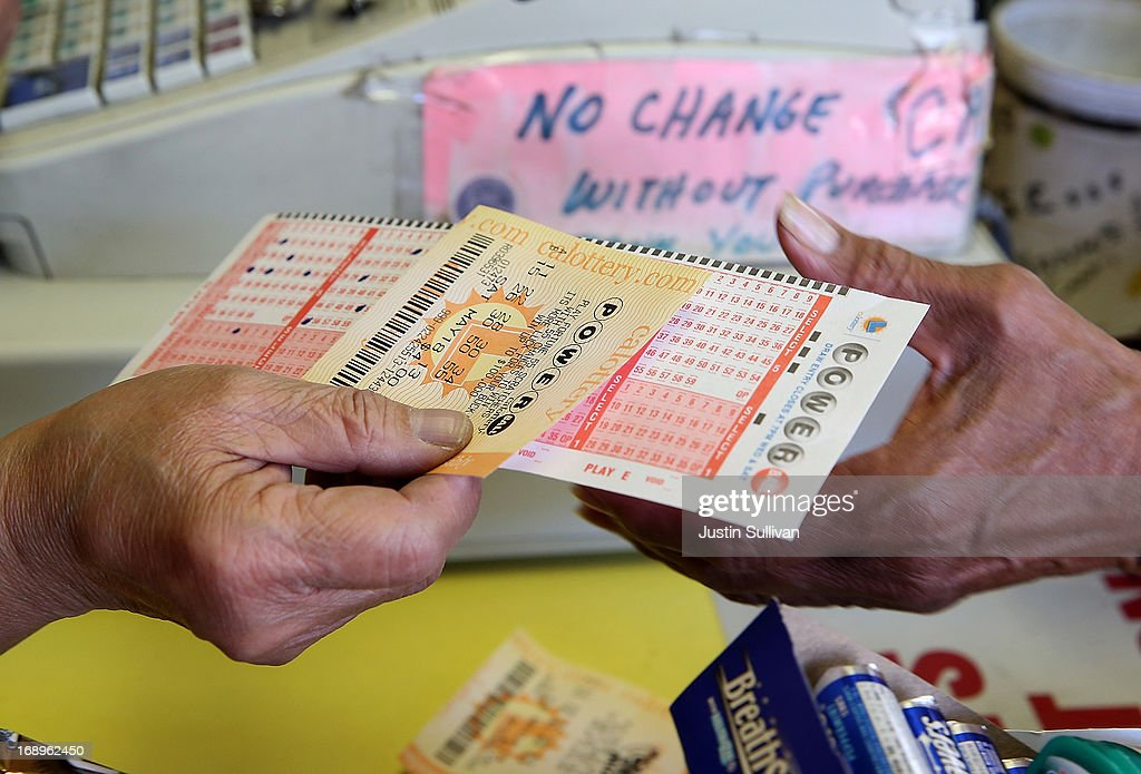 A customer purchases a Powerball ticket on May 17, 2013 in San Francisco, California. People are lining up to purchase $2 Powerball tickets as the multi-state jackpot hits $600 million.