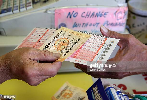 A customer purchases a Powerball ticket on May 17 2013 in San Francisco California People are lining up to purchase $2 Powerball tickets as the...