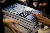 A customer purchases copies of US President Barack Obama's Fiscal Year 2016 Budget at the US Government Publishing Office in Washington DC US on...
