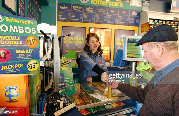 A customer purchases lottery tickets at a Tattersalls's agent in Melbourne Australia Tuesday July 5 2005 Tattersall's Ltd Australia's biggest lottery...
