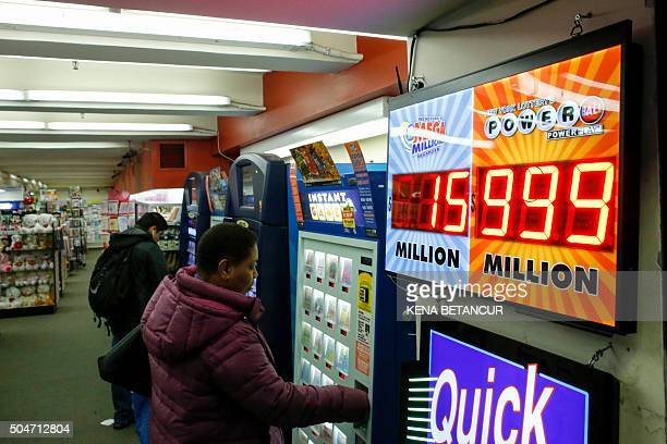 A customer purchases lottery tickets in Penn Station in New York on January 12 2016 Record sales drove up the largest jackpot in US history to a...