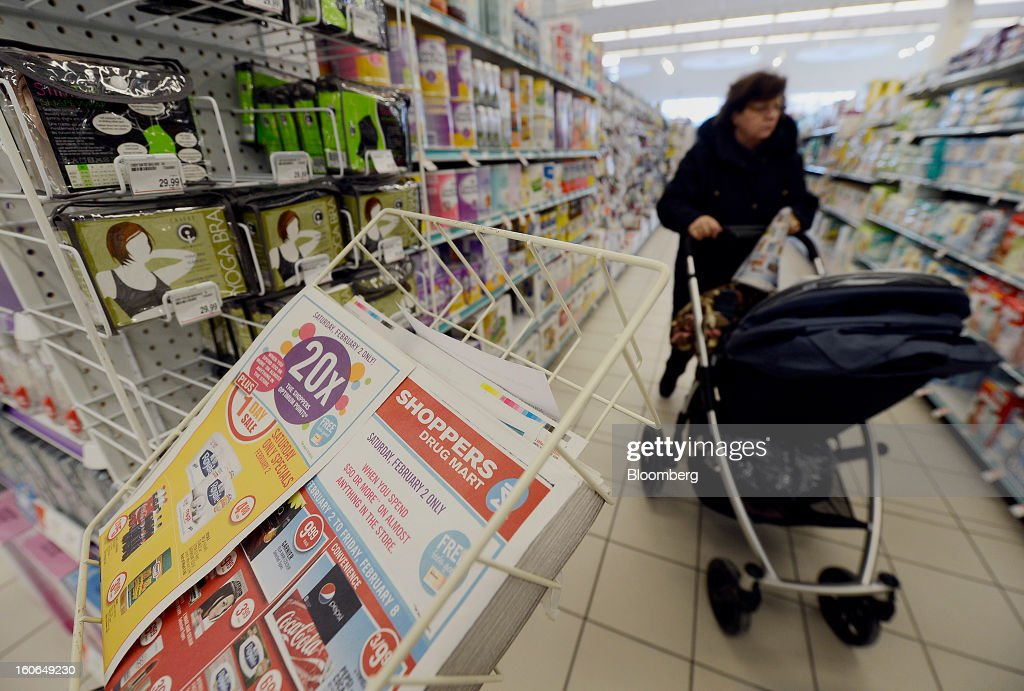 A customer pushes a baby carriage at a Shoppers Drug Mart Corp. store in Toronto, Ontario, Canada, on Monday, Feb. 4, 2013. Shoppers Drug Mart Corp., Canada's largest pharmacy chain, is scheduled to release earnings data on Feb. 7. Photographer: Aaron Harris/Bloomberg via Getty Images
