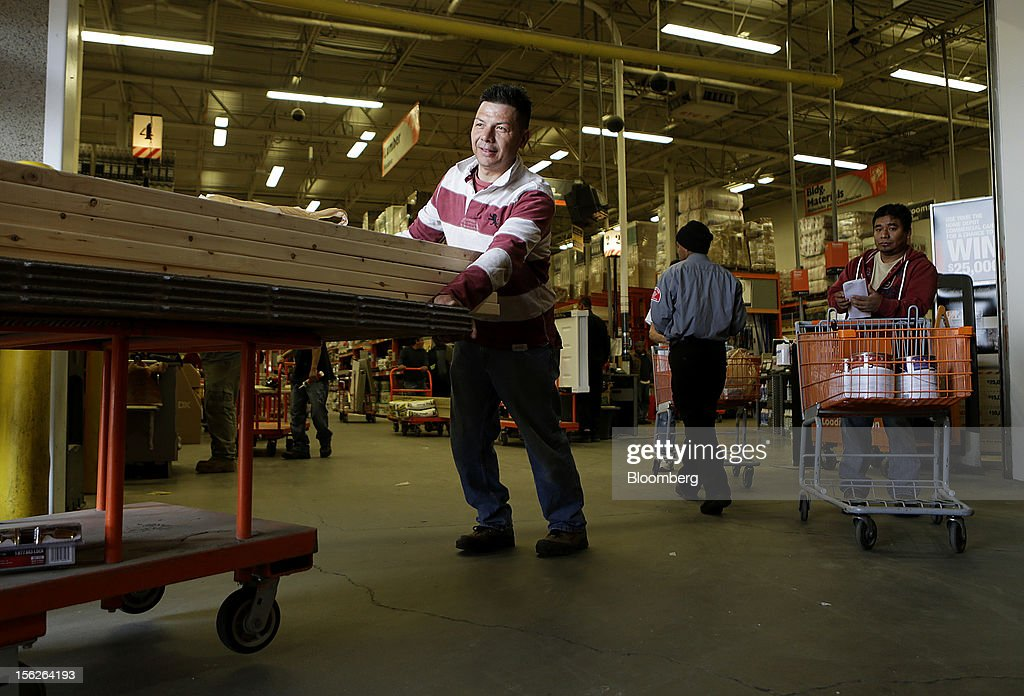 A customer pushes a cart loaded with lumber out of a Home Depot Inc. store in Washington, D.C., U.S., on Monday, Nov. 12, 2012. Home Depot Inc. is scheduled to release earnings data on Nov. 13. Photographer: Andrew Harrer/Bloomberg via Getty Images
