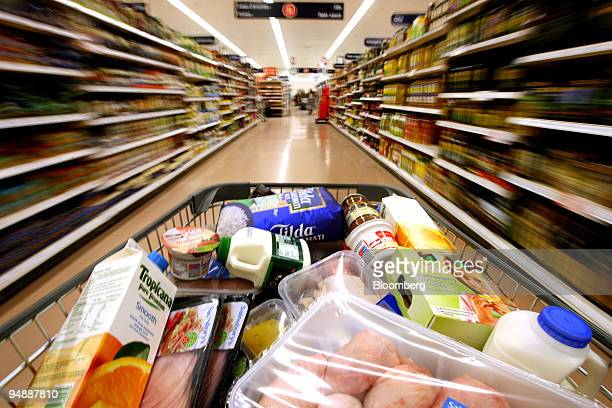 A customer pushes a grocery cart through the food aisles at a Sainsbury's supermarket in London Colney UK on Friday Feb 29 2008 J Sainsbury Plc the...
