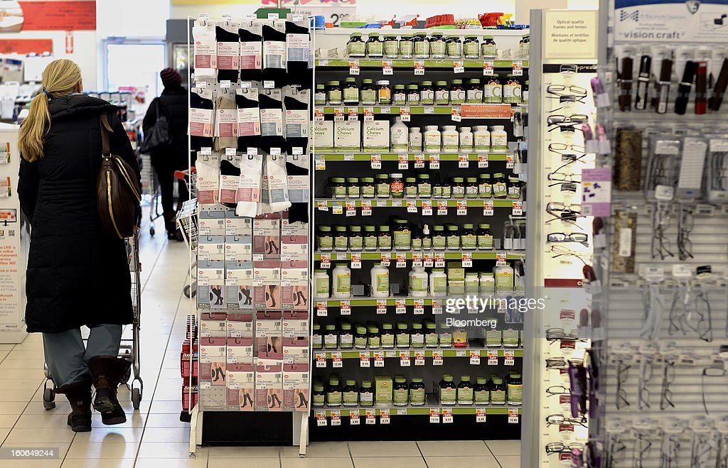 A customer pushes a shopping cart at a Shoppers Drug Mart Corp. store in Toronto, Ontario, Canada, on Monday, Feb. 4, 2013. Shoppers Drug Mart Corp., Canada's largest pharmacy chain, is scheduled to release earnings data on Feb. 7. Photographer: Aaron Harris/Bloomberg via Getty Images