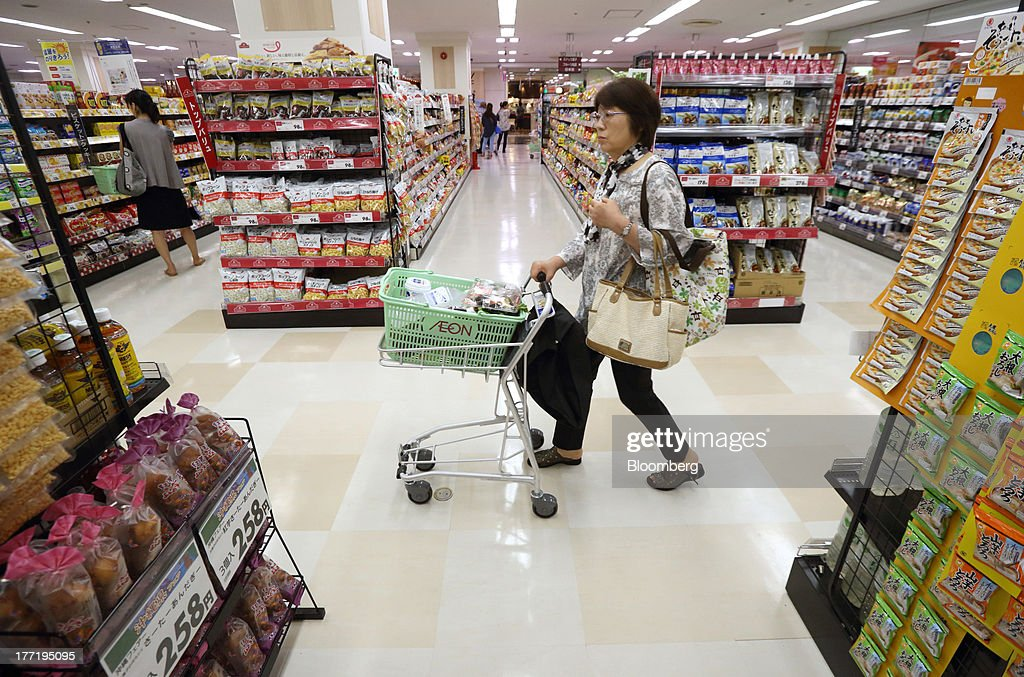 A customer pushes a shopping cart at an Aeon Co. supermarket during a sale jointly held with Daiei Inc. at an Aeon supermarket in Tokyo, Japan, on Thursday, Aug. 22, 2013. Aeon's acquisition of 48.4 million Daiei shares will take place on Aug. 27 after the completion of tender offer yesterday, according to a statement to the Tokyo Stock Exchange released today. Photographer: Tomohiro Ohsumi/Bloomberg via Getty Images