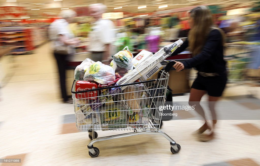 A customer pushes a shopping cart loaded with groceries inside a William Morrison Supermarkets Plc grocery store in Erith, U.K., on Wednesday, Sept. 5, 2012. Morrisons announced that 60 percent of store openings will be in southern England next year as it shifts attention from its northern heritage. Photographer: Chris Ratcliffe/Bloomberg via Getty Images