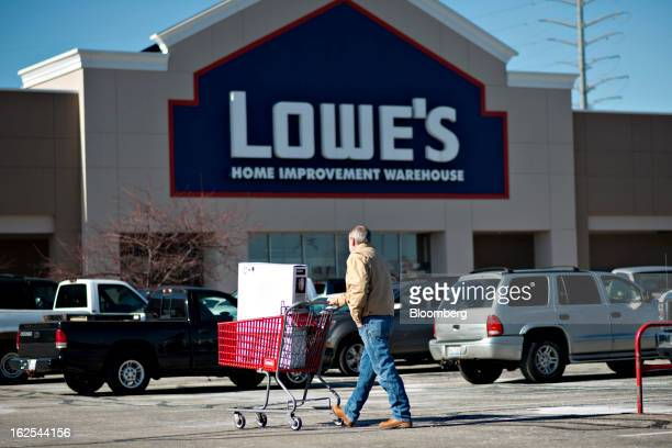 A customer pushes a shopping cart outside a Lowe's store in East Peoria Illinois US on Wednesday Feb 20 2013 Lowe's Cos the secondlargest US...