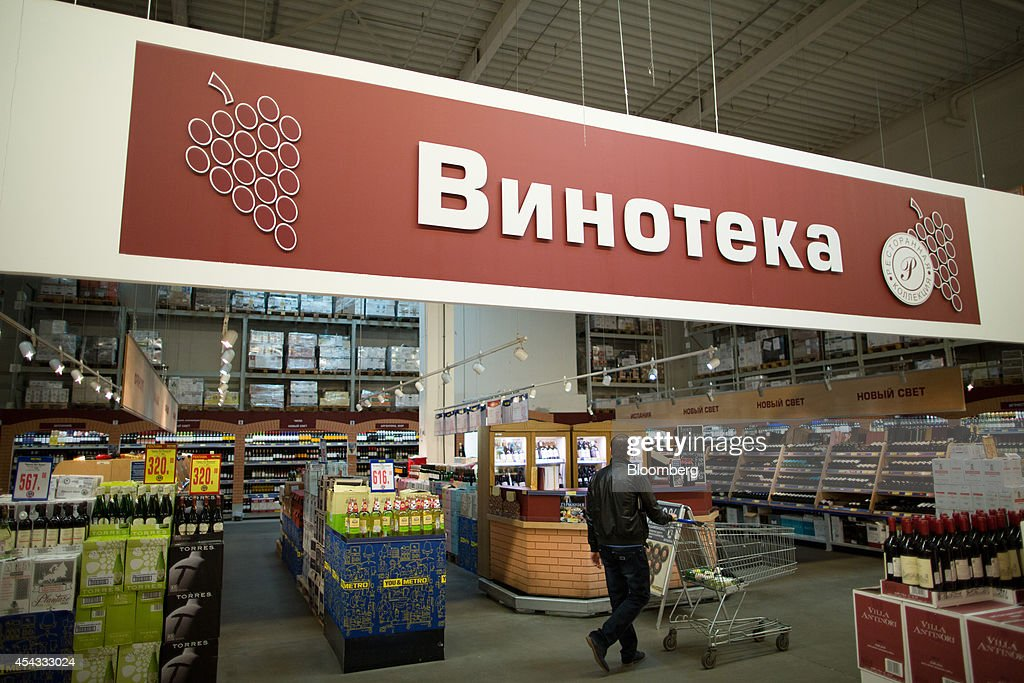 A customer pushes a shopping cart through the alcohol and wine section of a Metro Cash & Carry store, the Russia unit of Metro AG, in Moscow, Russia, on Friday, Aug. 29, 2014. Metro Cash & Carry has warned that domestic food suppliers are trying to increase some food prices as local produce is substituted for EU, Norwegian and U.S. equivalents which have been sanctioned. Photographer: Andrey Rudakov/Bloomberg via Getty Images