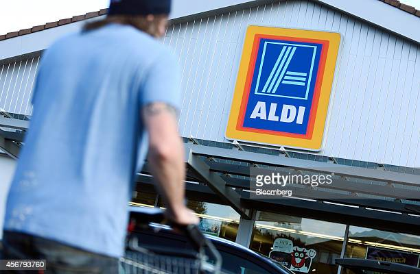 A customer pushes a shopping cart towards the entrance of an Aldi discount supermarket operated by Aldi Stores Ltd in Chelmsford UK on Tuesday Oct 7...