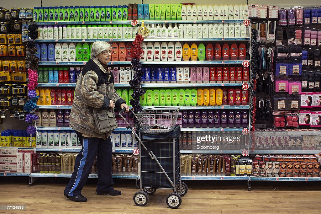 A customer pushes a shopping trolley past a display of hair-care products inside a Poundland discount store, operated by Poundland Group Plc in London, U.K., on Friday, March 7, 2014. Poundland Group Plc has demand for all the shares it is selling in an initial public offering that will value the U.K. discount retailer at as much as 750 million pounds ($1.3 billion), according to terms of the deal. Photographer: Simon Dawson/Bloomberg via Getty Images