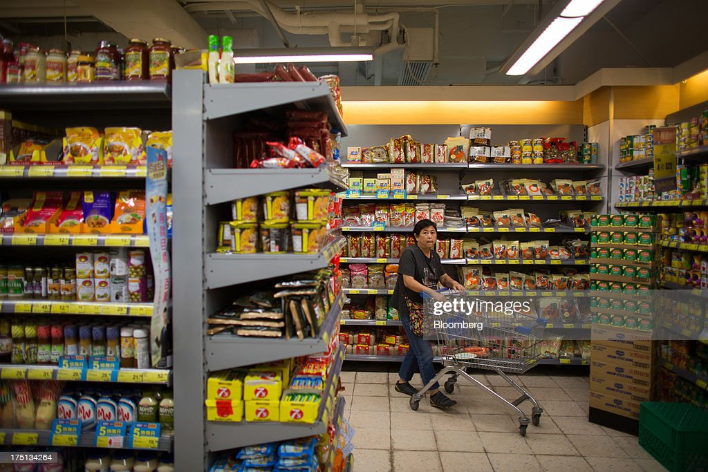 A customer pushes a shopping trolley through the packaged foods section of a ParknShop Superstore supermarket, operated by Hutchison Whampoa Ltd., in Hong Kong, China, on Thursday, Aug. 1, 2013. KKR & Co., the private-equity firm run by Henry Kravis and George Roberts, is evaluating a bid for Hong Kong supermarket chain ParknShop, according to two people with knowledge of the matter. Hutchison is seeking $3 billion to $4 billion for the chain and has asked potential buyers to submit bids by Aug. 16, people with knowledge of the process have said. Photographer: Lam Yik Fei/Bloomberg via Getty Images