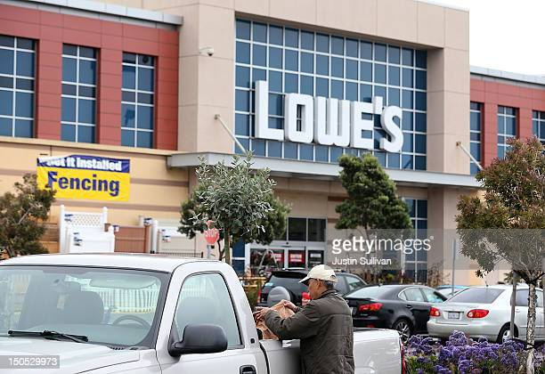 A customer puts plants in the back of his truck in the parking lot of a Lowe's store on August 20 2012 in South San Francisco California Home...