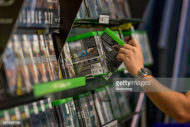 A customer reaches for a video game inside a GameStop Corp store in San Francisco California US on Tuesday March 24 2015 GameStop Corp is scheduled...