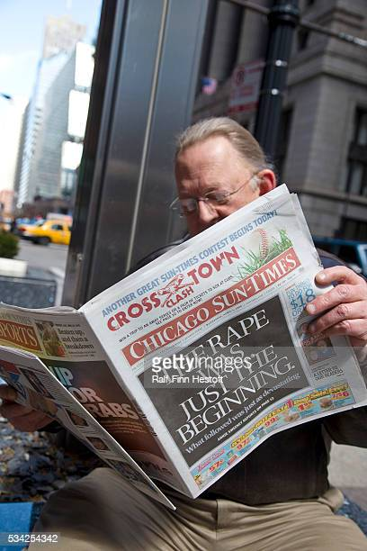 A customer reads the Chicago SunTimes in downtown Chicago The newspaper's owner the SunTimes Media Group filed for bankruptcy March 31 2009 Now both...