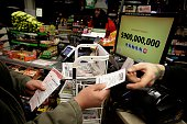 A customer receives Powerball tickets from a clerk at a 7Eleven store January 9 2016 in Chicago Illinois The Powerball Jackpot Surged to a record...