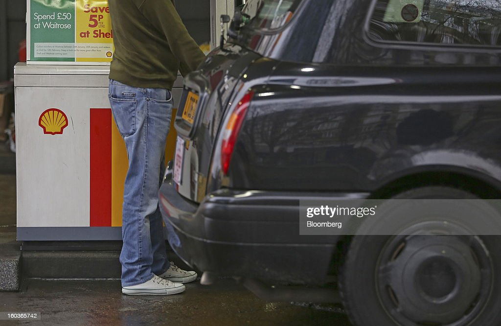 A customer refuel his London taxi at a Royal Dutch Shell Plc gas station in London, U.K., on Tuesday, Jan. 29, 2013. Oil traded near the highest level in four months ahead of a Federal Reserve policy statement that may signal the U.S. central bank will take additional steps to stimulate the economy. Photographer: Chris Ratcliffe/Bloomberg via Getty Images
