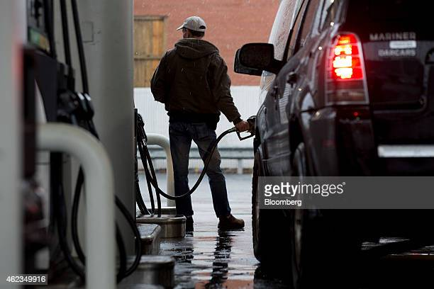 A customer refuels his vehicle at a Hess Corp gas station in Washington DC US on Monday Jan 26 2015 Hess Corp is expected to report fourthquarter...