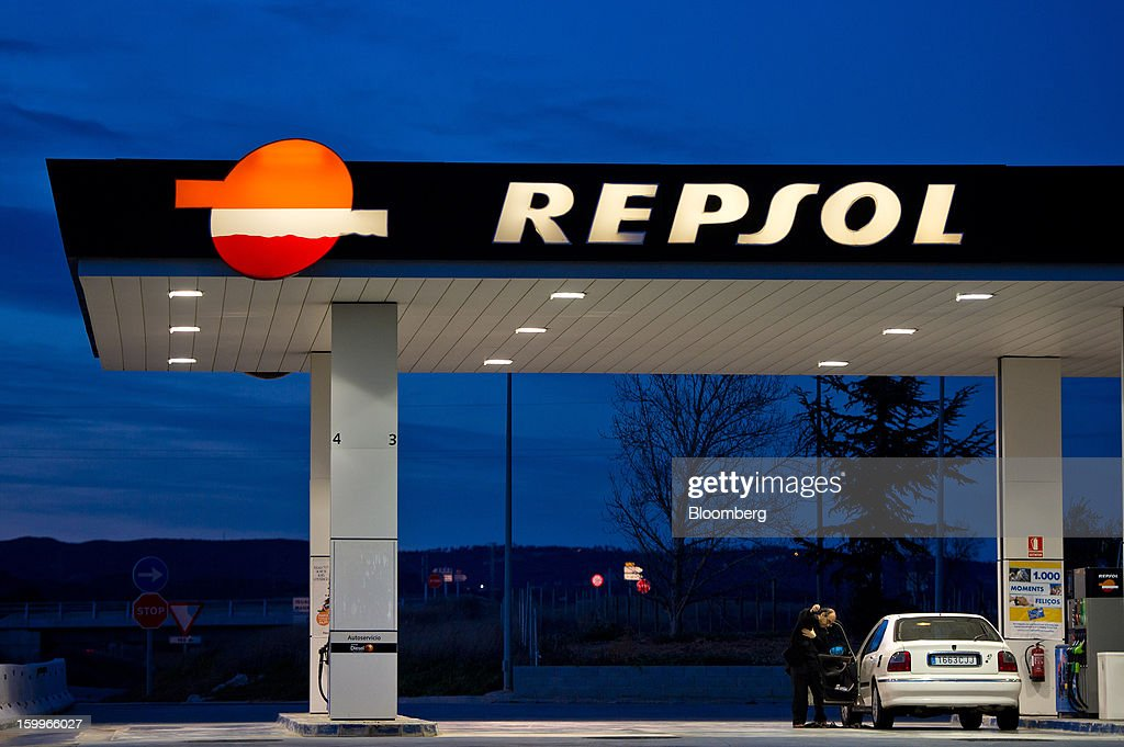A customer refuels his vehicle at a Repsol SA gas station in Puigdalbert, near Barcelona, Spain, on Wednesday, Jan. 23, 2013. Repsol SA, Spain's largest energy company, expects to sell liquefied natural gas assets for about 2 billion euros ($2.7 billion) by early February, according to a person familiar with the matter. Photographer: David Ramos/Bloomberg via Getty Images