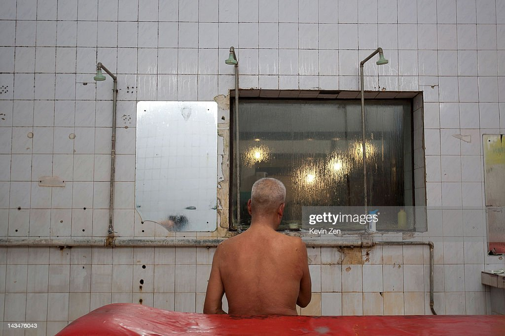 A customer rests after bathing at Shuangxing Tang Bathhouse on December 8, 2011 in Beijing, China. The Shuangxing Tang Bathhouse is the last remaining public bathhouse in Beijing and faces demolition as the area undergoes development. Opened on 1916, the bathhouse provides its patrons with a culture that is dying out, offering traditional treatments and massages it stands as a relic of the old Beijing, but with ever-decreasing water resources its future remains uncertain.