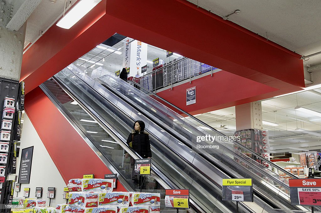 A customer rides the escalator at a Canadian Tire Corp. store in Toronto, Ontario, Canada, on Friday, Jan. 18, 2013. STCA - Statistics Canada is scheduled to release retail sales data on Jan. 21. Photographer: Reynard Li/Bloomberg via Getty Images