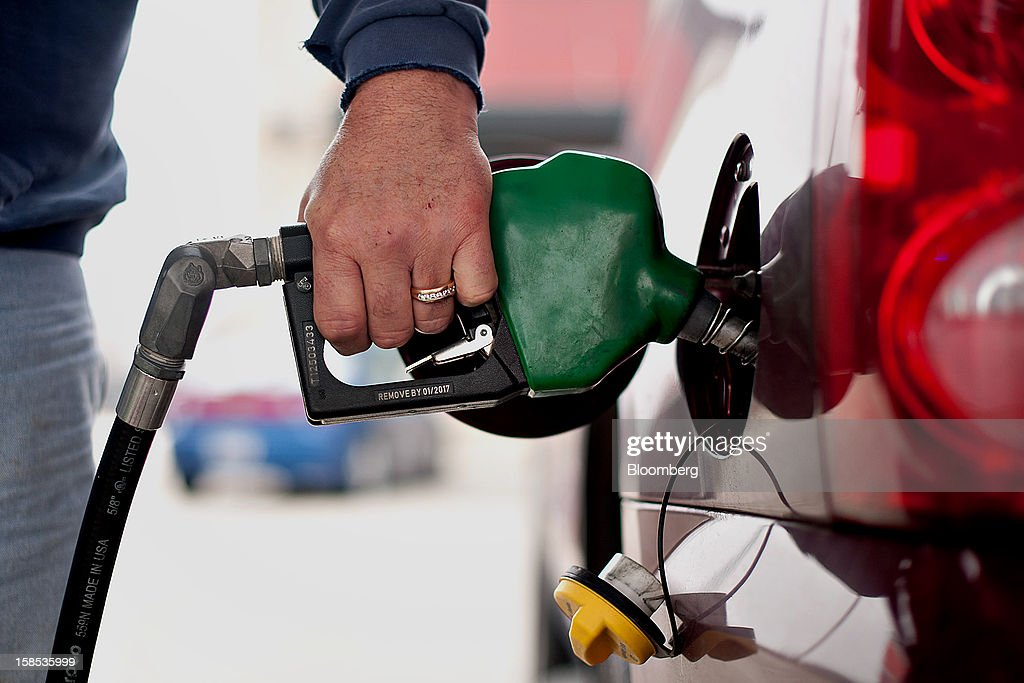 Customer Rodney Lange fills his vehicle with fuel at a gas station in Princeton, Illinois, U.S., on Tuesday, Dec. 18, 2012. Retail gasoline in the U.S. fell to the lowest level in a year as refineries restored production and stockpiles rose to an eight-month high, blunting criticism of President Barack Obama's energy policies. Photographer: Daniel Acker/Bloomberg via Getty Images