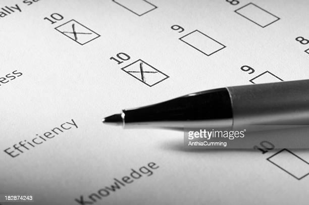 Customer satisfaction survey partially completed with pen