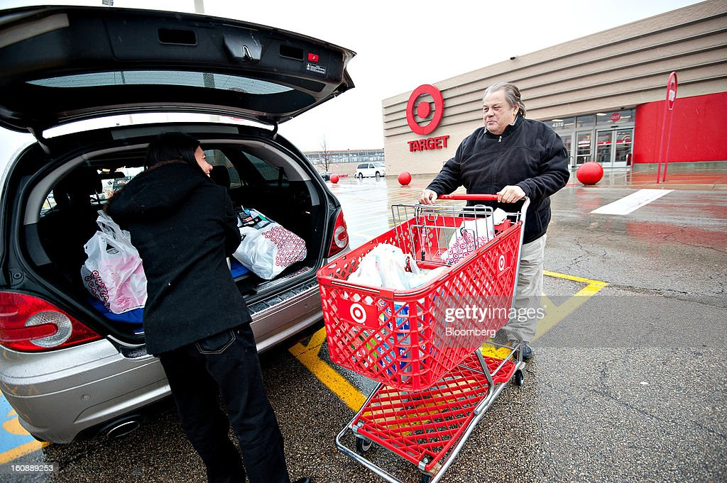 Customer Scotty Scassiferro, right, and his wife Maricar Scassiferro put purchases in their vehicle outside a Target Corp. store in Peru, Illinois, U.S., on Thursday, Feb. 7, 2013. Target Corp. led U.S. retailers to the biggest monthly same-store sales gain in more than a year as shoppers snapped up discounted merchandise chains were clearing out after the holidays. Photographer: Daniel Acker/Bloomberg via Getty Images