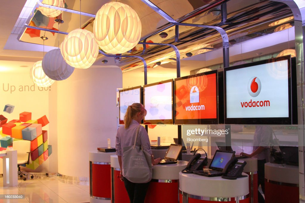 A customer searches for information on a laptop computer inside a Vodacom store at Vodaworld the headquarters of Vodacom Group Ltd Vodafone's biggest...