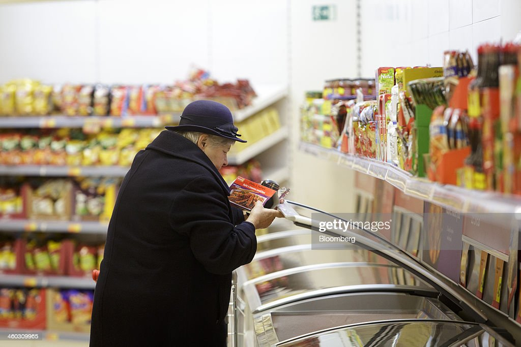A customer selects a Chinese ready-meal for sale inside an Iceland Foods Ltd. store in Prague, Czech Republic, on Friday, Jan. 3. 2014. The Czech Republic's 2013 budget deficit of 80.9 billion koruna ($4.01 billion) beat the 100 billion-koruna target after the government cut spending, the Finance Ministry said. Photographer: Martin Divisek/Bloomberg via Getty Images