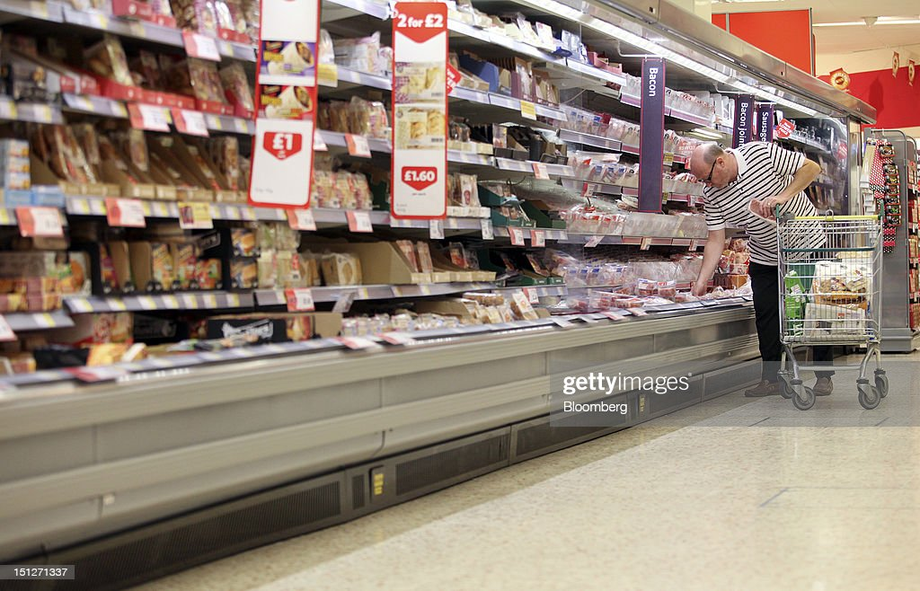 A customer selects a pack of bacon from the chilled-meat aisle inside a William Morrison Supermarkets Plc grocery store in Erith, U.K., on Wednesday, Sept. 5, 2012. Morrisons announced that 60 percent of store openings will be in southern England next year as it shifts attention from its northern heritage. Photographer: Chris Ratcliffe/Bloomberg via Getty Images