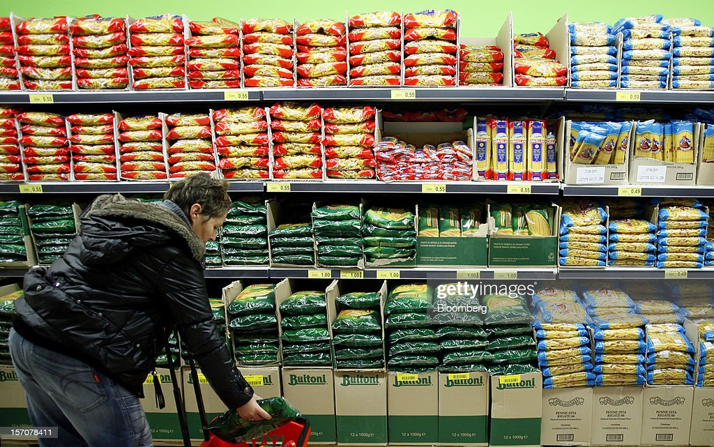 A customer selects a pack of Buitoni pasta, manufactured by Nestle SA, inside a OnePrice supermarket, operated by Gruppo BSE, in Monterotondo, Italy, on Wednesday, Nov. 28, 2012. Italy needs to uphold Prime Minister Mario Monti's pledge to shore up public finances in order to enjoy investor confidence even after elections due by April, the Organization for Economic Cooperation and Development said in its latest Economic Outlook report this week. Photographer: Alessia Pierdomenico/Bloomberg via Getty Images