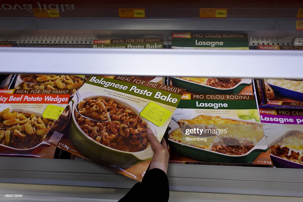 A customer selects a ready-meal box from a freezer unit stocked with frozen processed meat products inside an Iceland Foods Ltd. store in Prague, Czech Republic, on Friday, Jan. 3. 2014. The Czech Republic's 2013 budget deficit of 80.9 billion koruna ($4.01 billion) beat the 100 billion-koruna target after the government cut spending, the Finance Ministry said. Photographer: Martin Divisek/Bloomberg via Getty Images