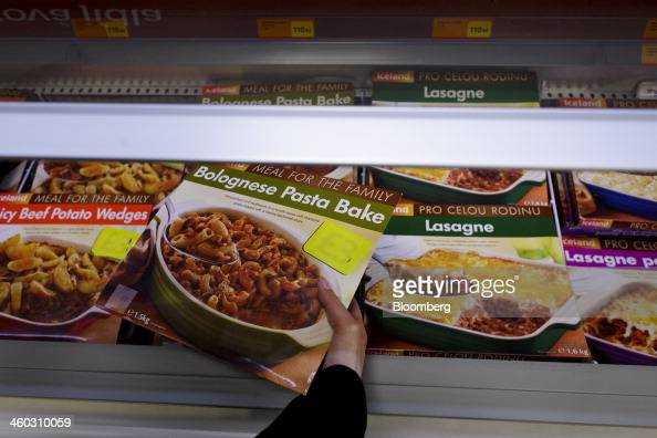A customer selects a readymeal box from a freezer unit stocked with frozen processed meat products inside an Iceland Foods Ltd store in Prague Czech...