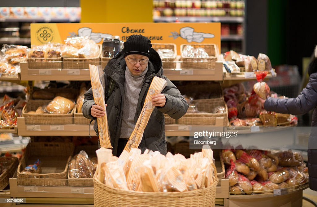 A customer selects baguettes in the baked goods area inside a Perekrestok supermarket operated by X5 Retail Group in Moscow Russia on Tuesday Feb 4...
