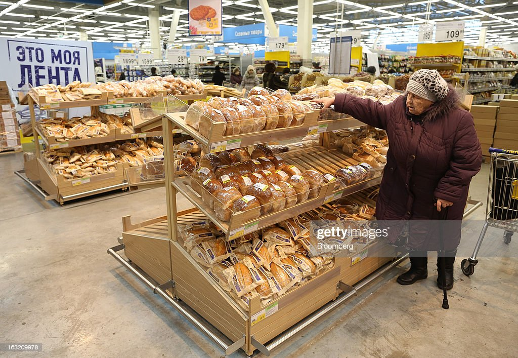 A customer selects bread from a shelf in the bakery section of a Lenta LLC supermarket in Prokopyevsk, Kemerevo region, Russia, on Wednesday, March 6, 2013. Lenta LLC, a Russian hypermarket operator controlled by TPG Capital, is selling its first bond to expand after using company funds for a leveraged buyout by the U.S. firm. Photographer: Andrey Rudakov/Bloomberg via Getty Images