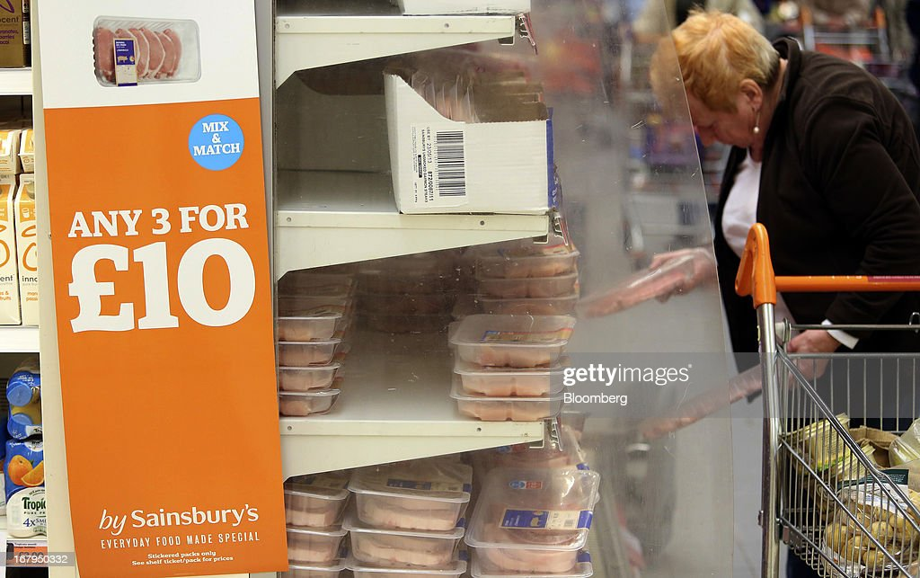 A customer selects chilled packets of meat from the fresh food aisle inside a Sainsbury's supermarket store, operated by J Sainsbury Plc, in Godalming, U.K., on Thursday, May 2, 2013. J Sainsbury Plc, the U.K.'s third-largest supermarket chain, will report full year results on May 8. Photographer: Chris Ratcliffe/Bloomberg via Getty Images