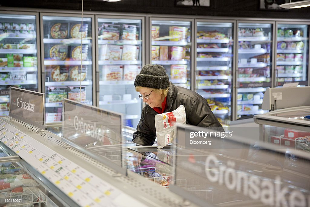 A customer selects food from a freezer cabinet inside an ICA supermarket store in Stockholm, Sweden, on Tuesday, Feb. 19, 2013. Hakon Invest AB, the minority owner of Sweden's largest food retailer ICA, agreed to take full control by acquiring partner Royal Ahold NV's 60 percent stake for 20 billion kronor ($3.1 billion). Photographer: Casper Hedberg/Bloomberg via Getty Images