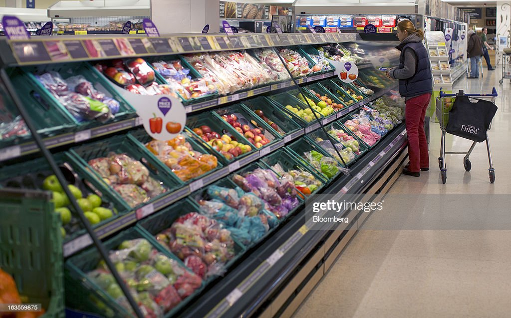 A customer selects goods from the chilled fruit and vegetable section inside a Tesco Plc supermarket in the borough of Kensington in London, U.K., on Tuesday, March 12, 2013. Tesco Plc, the U.K.'s largest grocer launched a 'Price Promise', its latest initiative offering to match the price of customers' purchases to that of it's rivals, including Wal-Mart Stores Inc.'s ASDA. Photographer: Simon Dawson/Bloomberg via Getty Images