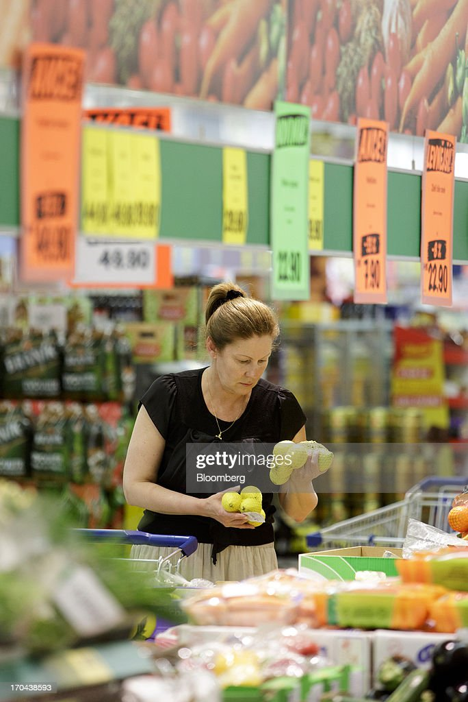 A customer selects lemons for sale in the fresh food section of a Lidl discount supermarket store, operated by Schwarz Group, in Prague, Czech Republic, on Thursday, June 13, 2013. Ahold and Tesco are tied as the Czech Republic's third-largest grocer by revenue behind Lidl discount store owner Schwarz Group and Rewe AV, which owns the Billa supermarkets, according to Krakow, Poland-based market researcher PMR. Photographer: Martin Divisek/Bloomberg via Getty Images