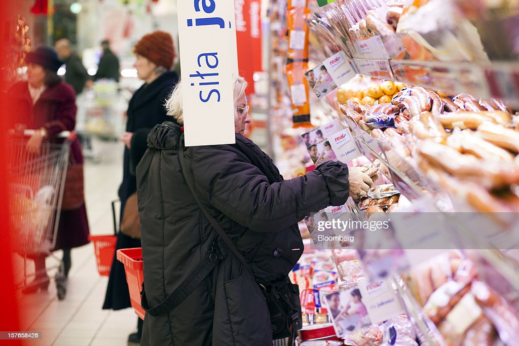 A customer selects meat products from a display inside a Real supermarket in Wroclaw, Poland, on Wednesday, Dec. 5, 2012. Metro AG, Germany's biggest retailer, agreed to sell its Real grocery stores in eastern Europe to Groupe Auchan SA of France for 1.1 billion euros ($1.4 billion) in Chief Executive Officer Olaf Koch's first big deal since taking the helm. Photographer: Bartek Sadowski/Bloomberg via Getty Images