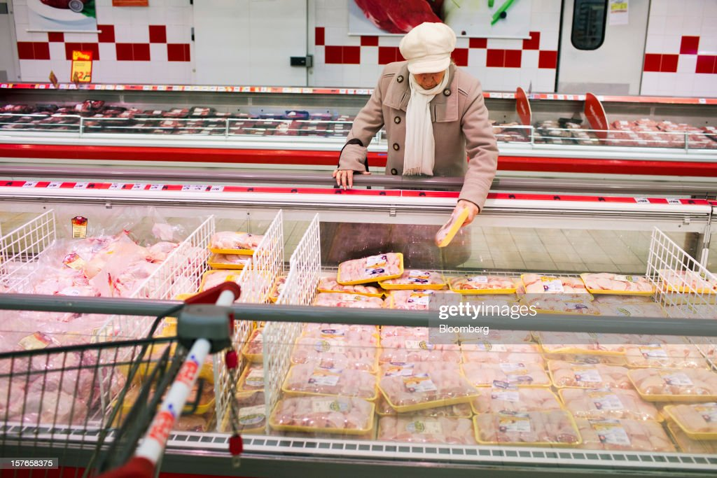 A customer selects meat products from a freezer inside a Real supermarket in Wroclaw, Poland, on Wednesday, Dec. 5, 2012. Metro AG, Germany's biggest retailer, agreed to sell its Real grocery stores in eastern Europe to Groupe Auchan SA of France for 1.1 billion euros ($1.4 billion) in Chief Executive Officer Olaf Koch's first big deal since taking the helm. Photographer: Bartek Sadowski/Bloomberg via Getty Images