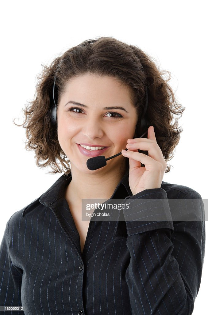 'Customer service agent with headset, looking at the camera'