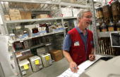Customer Service Associate Doug Ferket prints out price stickers for available inwindow air conditioners at the Lowe's home improvement store August...