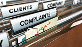 Close up on a file tab with the word complaints, focus on the main text and blur effect. Concept image for illustration of Customer Service complaint management