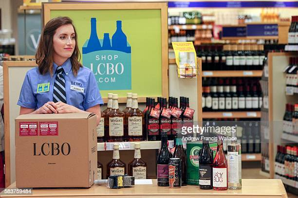 TORONTO ON JULY 26 LCBO customer service representative Elsbeth Lumley showing shipping box with legal drinking age warning label during launch for...