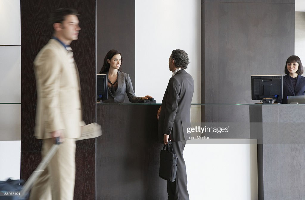 Customer service representative helping businessman : Stock Photo