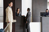 Customer service representative helping businessman