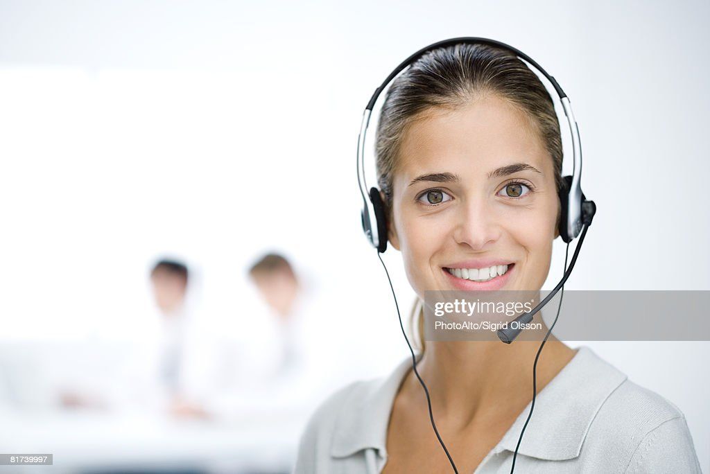 Customer service representative with headset, smiling at camera, portrait